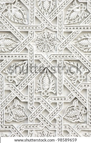 closeup of a wall of white plaster Arabic