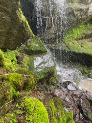 Closeup of a water dropping on the rocks of a waterfall in Vitosha mountain in Sofia.