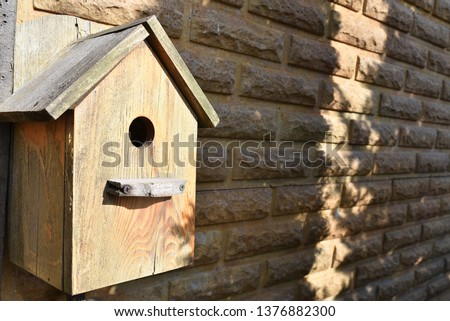 Closeup of a weathered birdhouse. wooden nesting box. #1376882300