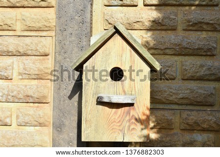 Closeup of a weathered birdhouse. wooden nesting box. #1376882303
