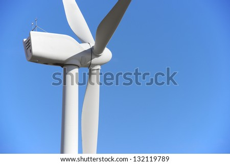 closeup of a windmill for renewable electric energy production