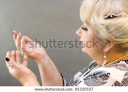 Closeup of a woman holding a crystal balls in her hands