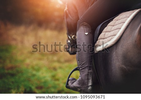 closeup of a woman in riding...