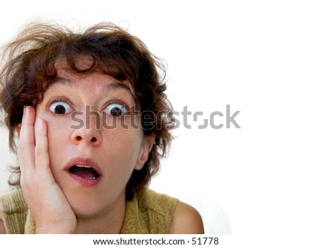 Closeup of a woman's face surprised by something