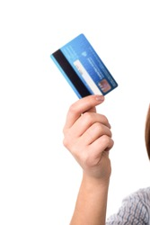 Closeup of a woman's hand holding up a credit card.