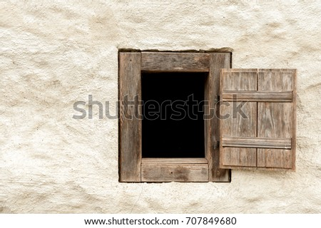 Closeup of a wooden window of an old farming house in Austria