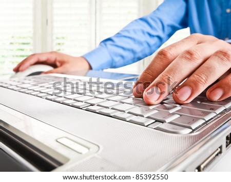 Closeup of a worker using a laptop computer
