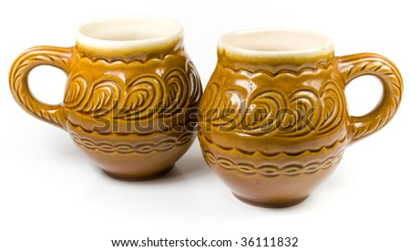 Closeup of a yellow decorative earthen jars, isolated on a white background.