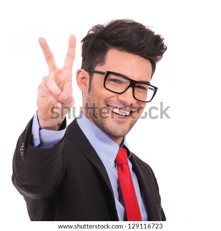 closeup of a young business man showing victory sign on white background