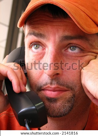 stock photo : closeup of a young mature man, having a hard time on the