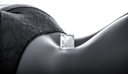 Closeup of a young woman with an ice cube