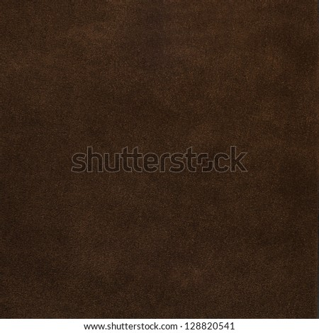 Closeup of abstract grunge brown paper background.