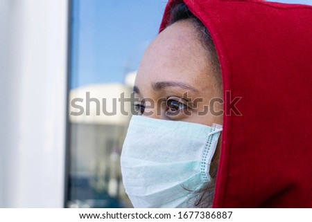 Closeup of african american woman in medical mask looks ahead. Protection against covid-19, virus and infection. People wear mask prevention walking.