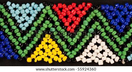 closeup of african bead work in triangular geometric pattern - stock photo