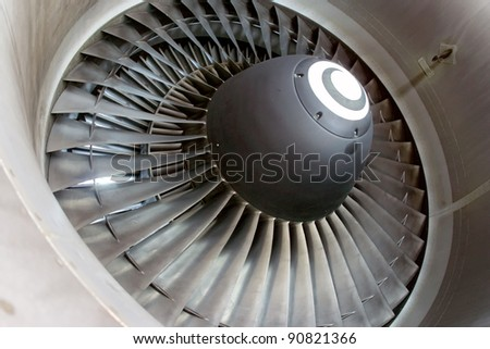 Closeup of aircraft jet engine at the hangar.