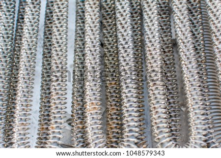 closeup of aluminum tube is a material of air conditioner or recycling of material (Reduce, Reuse, Recycle) concept of industry development, market of raw materials and Metal is recyclable material. #1048579343