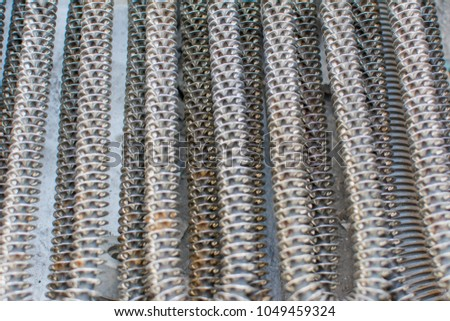 closeup of aluminum tube is a material of air conditioner or recycling of material (Reduce, Reuse, Recycle) concept of industry development, market of raw materials and Metal is recyclable material. #1049459324