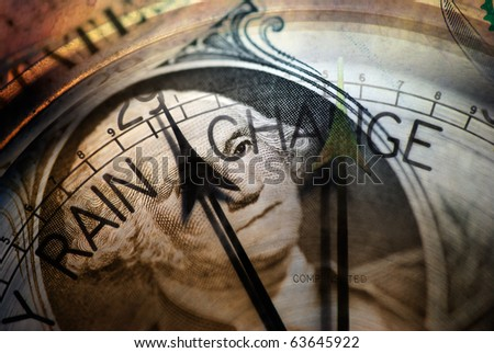 Closeup of American dollar overlaid with barometer face