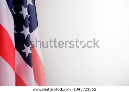 Closeup of American flag on plain background #1043921962
