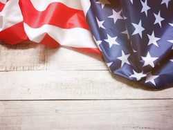 Closeup of American flag on vintage wood for 4th of July holiday background, filter effect. Happy flag day.