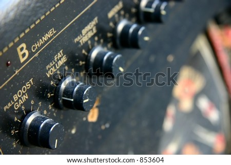 Closeup of amplifier dials and knobs