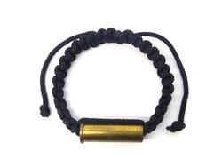 Closeup of amulet rope bracelet on white background.