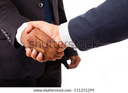 Closeup of an african and caucasian business man handshake - isolated on white