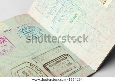 Closeup of an American passport with stamps from a variety of countries within the past couple of years, including England, Australia, Japan, and the Republic of Korea.
