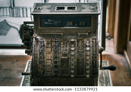 Closeup of an antique cash register located in a room within the concept of money. Instagram filter. #1133879921