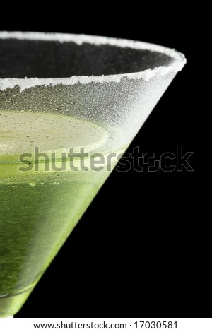 Closeup of an appletini on a black background
