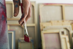Closeup of an artist holding paintbrush