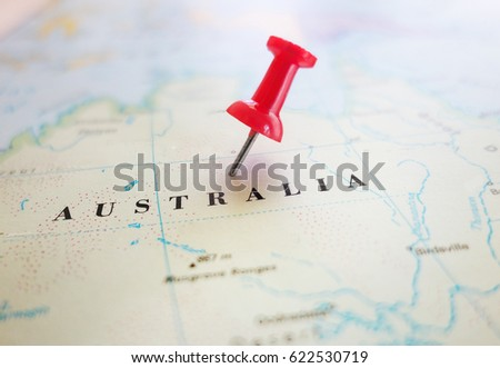 Closeup of an Australia map with red thumb tack                                #622530719