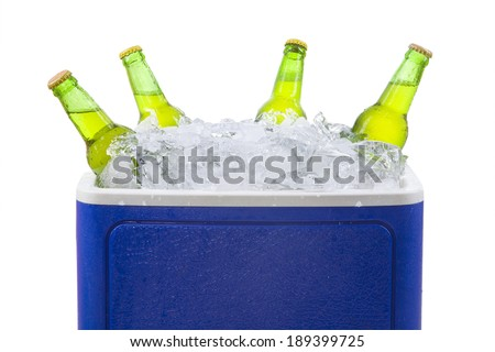 Closeup of an ice chest full of ice and assorted beer bottles. isolated on white - stock photo