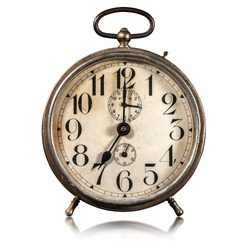 Closeup of an old alarm clock isolated on white background, seven o'clock. Italy.