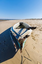 closeup of an old fishing boat stranded on a beach of a fishing village, in the Arcachon bay, France