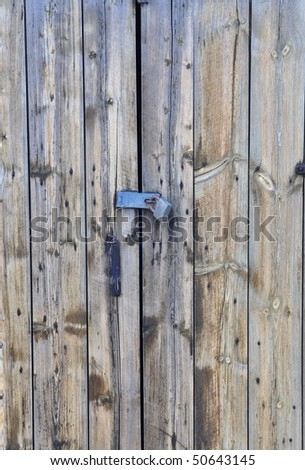 closeup of an old shed door with a lock on it