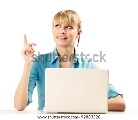Closeup of an young college girl with a laptop sitting at the desk