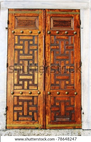 Closeup of ancient wooden doors in Blue Mosque-Istanbul