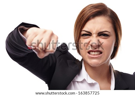 Closeup of angry businesswoman punching isolated on white background
