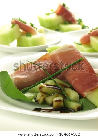Closeup of appetizer: melon and parma ham