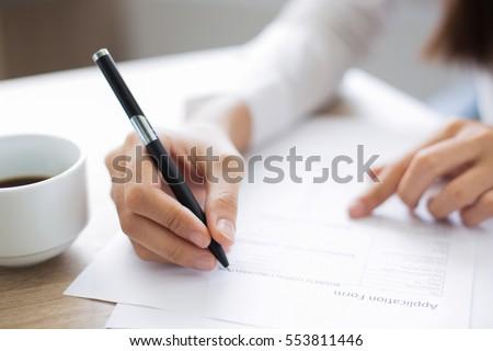 closeup of applicant completing ...