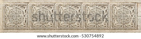 Closeup of architectural ornament. Stone carving of flower motif pattern