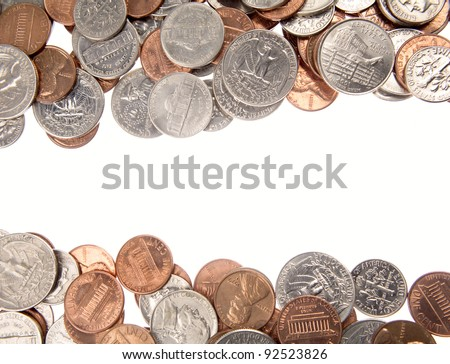 Closeup of assorted American coins on plain white background. Copy space