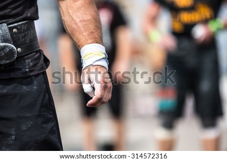 Closeup of athlete hand before his attempt to lift barbell