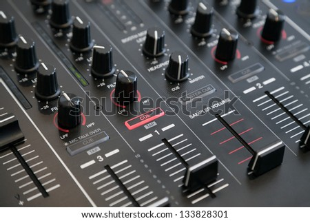 Closeup of audio mixer with selective focus