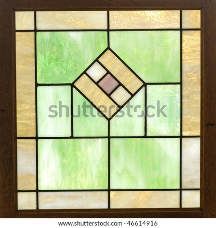 Closeup of back lighting on an antique lead glass window in a square format