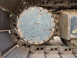 Closeup of backhoe track sprocket wheel