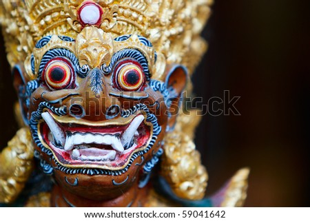Closeup of Balinese God statue in temple complex