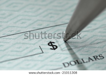 Closeup of ballpoint pen writing on a blank bank check, ready to fill in the dollar amount; selective focus on the tip of the pen, very shallow DOF
