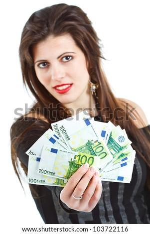 Closeup of banknotes - euros - held by a beautiful young woman with long brown hair, smiling in the background - isolated on white